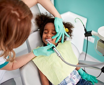 Child receiving teeth cleaning
