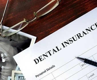 dental insurance form with a pen on top of it