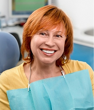 Older woman in dental chair smiling