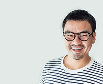 person with glasses smiling