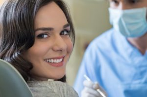 woman smiling dentist chair